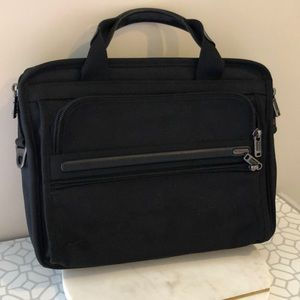 Compact TUMI computer bag.